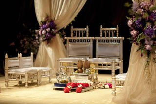 hindu-wedding-mandap-with-golden-chairs-and-cream-cushions