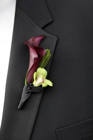 groomsmen-wearing-black-wrapped-flowers-on-lapel