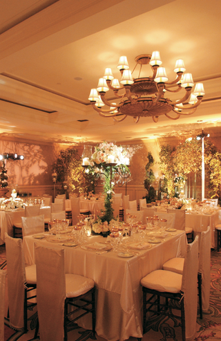 wedding-reception-with-white-tables-and-candelabra-centerpieces