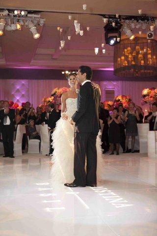 bride-and-groom-dancing-on-ballroom-floor