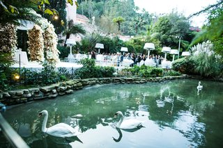 hotel-bel-air-wedding-ceremony-location-flower-arch-with-pond-nearby-swans-swan-lake