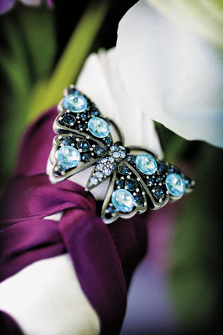 wedding-bouquet-hand-tied-with-red-ribbon-and-decorated-with-a-butterfly-with-blue-crystals