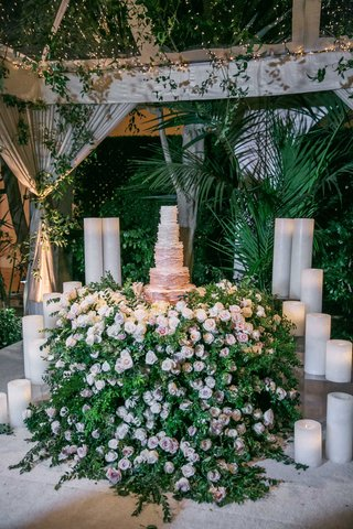 wedding-reception-cake-table-with-hundreds-of-flowers-greenery-ombre-ruffle-wedding-cake-tent