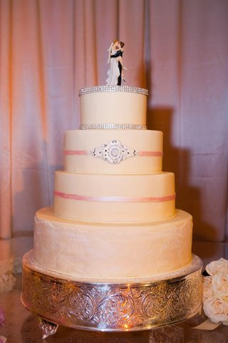 four-layer-cake-with-pink-ribbons-and-rhinestones