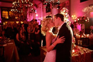 bride-and-groom-kiss-in-front-of-wedding-guests