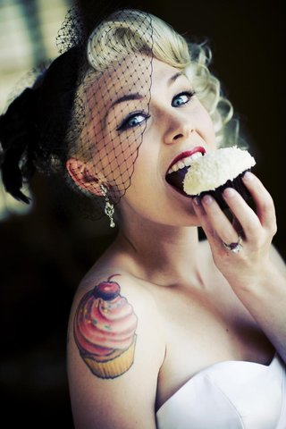 bride-in-a-black-wedge-veil-eats-a-sprinkles-cupcake