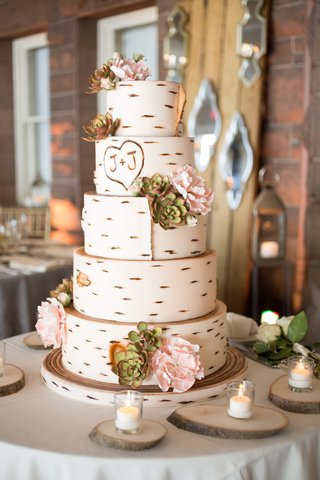 white-wedding-cake-made-to-resemble-a-birch-tree-with-the-couples-initials-carved-on-it
