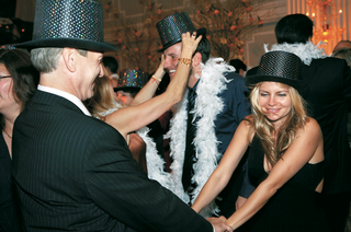 wedding-guests-dancing-in-party-hats-and-boas