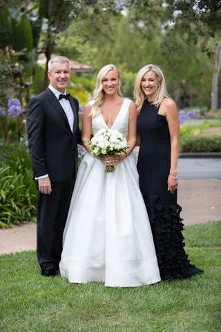 formal black tie wedding bride in v neck anne barge wedding dress mom in black dress skirt detail