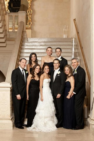 bride-and-groom-with-guests-in-black-tie-clothing