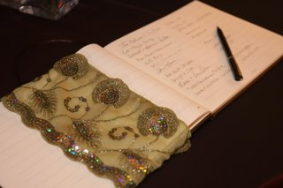 intricate-beaded-fabric-on-simple-guestbook