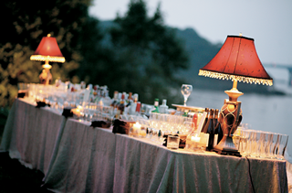 drinks-served-on-table-decorated-with-red-lampshades