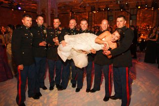 bride-lifted-up-at-reception-by-usmc-men