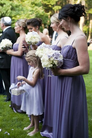 bridesmaids-with-flower-girl-in-purple-dresses