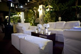 outdoor-lounge-area-with-white-sofas-and-armchairs