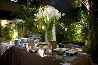 sprinkles-cupcake-station-at-wedding-reception