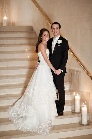 monique-lhuillier-wedding-dress-with-tiered-skirt-and-groom