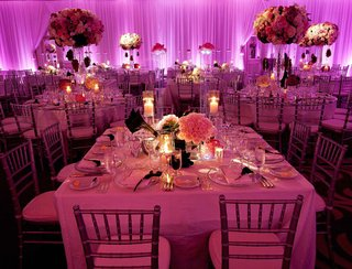 purple-and-pink-lighting-at-large-indoor-wedding-reception