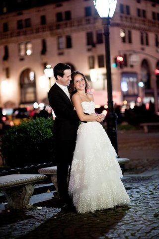 bride-and-groom-embrace-in-square-in-nyc