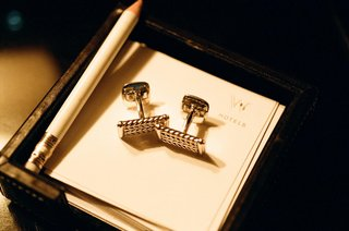 groom-cufflinks-on-w-hotel-paper-in-hotel-room