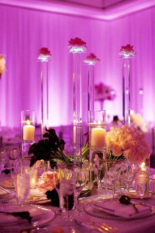 purple-and-pink-lighting-on-wedding-reception-table-with-crystal-stands