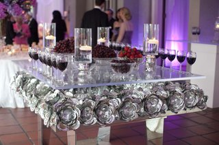 silver-flower-reception-decoration-with-glass-table