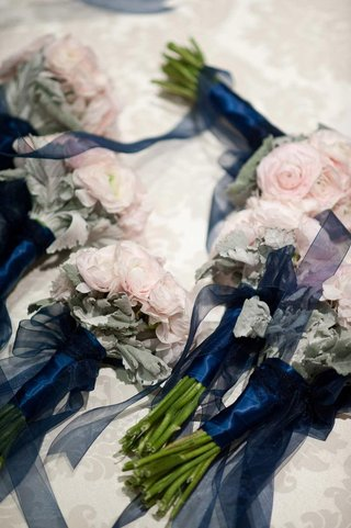 pink-ranunculus-tied-with-navy-blue-ribbon