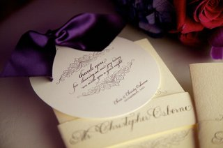 white-circle-stationery-with-purple-script-and-ribbon