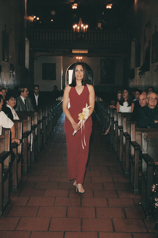 bridesmaid-wearing-cherry-gown-down-aisle