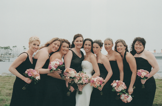 bride-with-bridesmaid-in-black-gowns-and-pink-bouquets