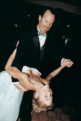 smiling-newlyweds-dancing-at-reception