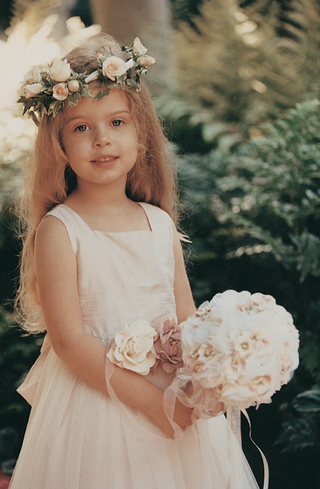 pretty-flower-girl-with-rose-flower-crown-and-belt
