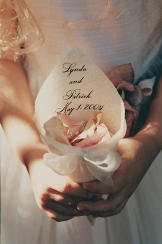 flower-girl-holds-ivory-cone-filled-with-petals