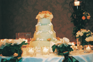 four-layer-wedding-cake-with-ivory-and-orange-flowers