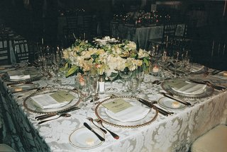 reception-table-with-luxurious-linens-and-flowers
