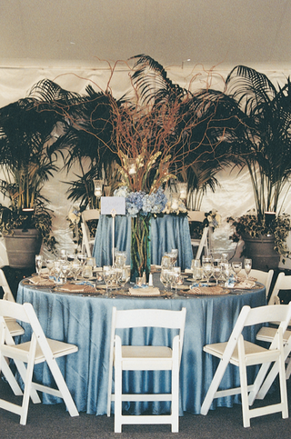 indoor-palm-trees-and-blue-wedding-reception-tables