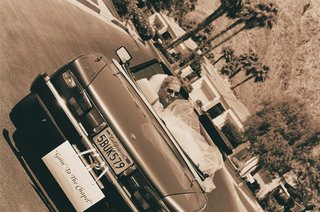 sepia-tone-wedding-getaway-car-in-palm-springs