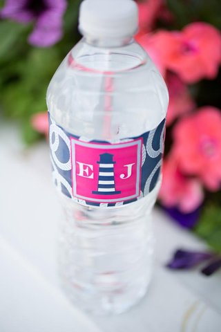pink-and-navy-blue-water-bottle-label-with-lighthouse-design