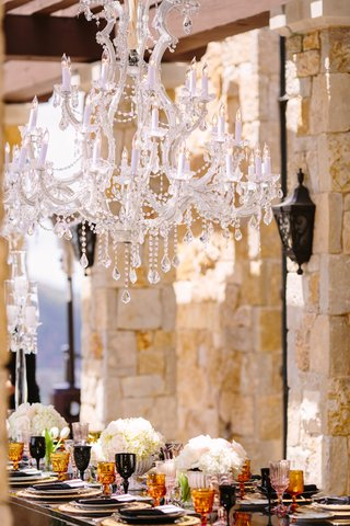 a-crystal-chandelier-was-above-the-black-reception-table