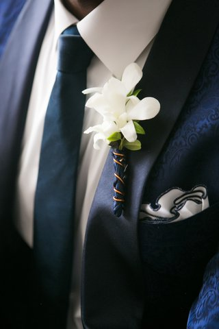 wedding boutonniere white orchid blue wrap white pocket square navy tuxedo and tie