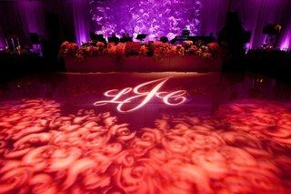 red-gobo-lighting-projection-on-wedding-reception-dance-floor
