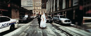bride-and-groom-in-wedding-attire-in-the-street