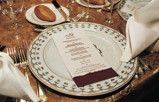 red-and-white-menu-card-on-patterned-plate