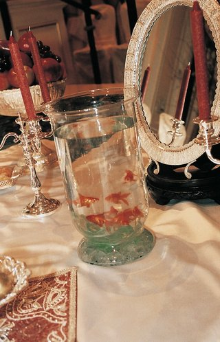 glass-vessel-filled-with-water-and-gold-fish