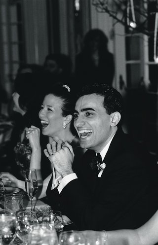 black-and-white-photo-of-couple-laughing-at-reception