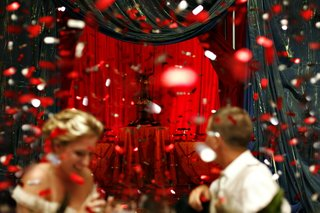 guests-dancing-with-red-confetti-at-wedding-reception