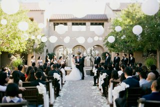 bride-and-groom-married-in-senna-plaza-paper-lanterns-and-string-lights-outdoor-ceremony