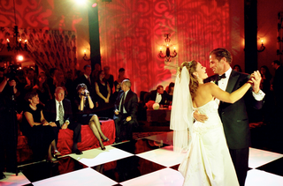 bride-and-groom-first-dance-on-checker-dance-floor