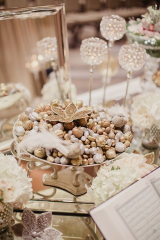 wedding-ceremony-persian-wedding-sofreh-table-at-ceremony-candies-and-candles-on-table-traditional