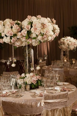 lace-table-linens-with-tall-floral-centerpieces